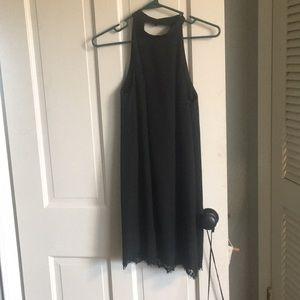 Black tent dress, open back.